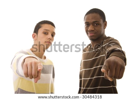 Two young men pointing to you isolated on white