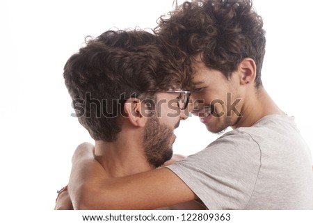 Two young men portrait playing together isolate on white background