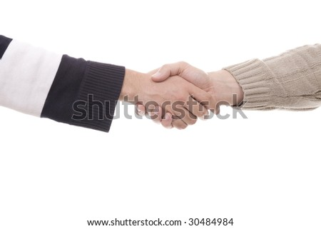 two young men shaking hands