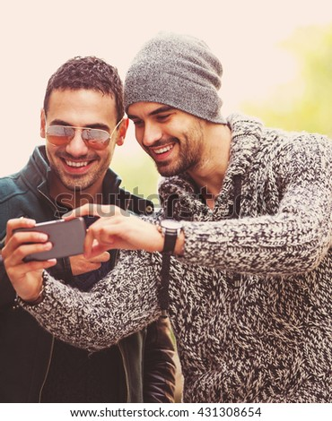 Two young men with a Smart phone - stock photo