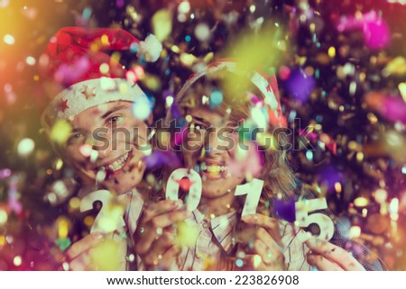 Two young people celebrating New Year's eve - stock photo