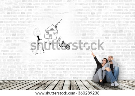 Two young people dreaming about a new home better. - stock photo