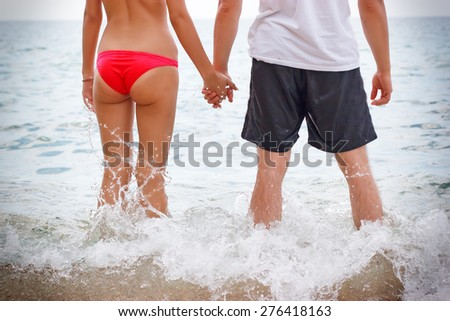 Two young people on the beach in the shallows