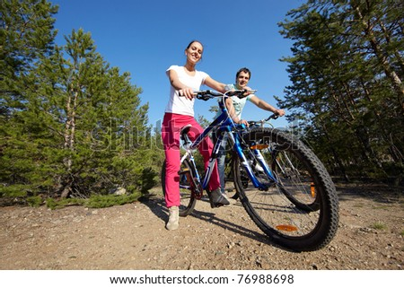 Two young people on their bikes outside