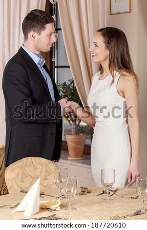 Two young people shaking hands on a date - stock photo
