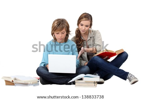 Two young people studying together - stock photo