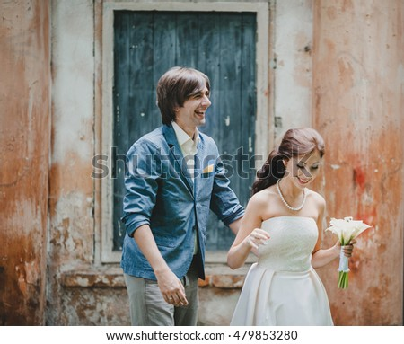 Two young people walk in the wedding day