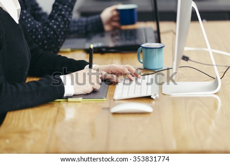 two young people working in an office - stock photo