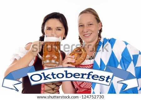 Two young pretty women in dirndl with beer mug / Oktoberfest - stock photo