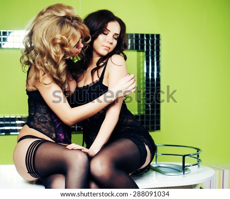 two young sensual women in lingerie. love. - stock photo