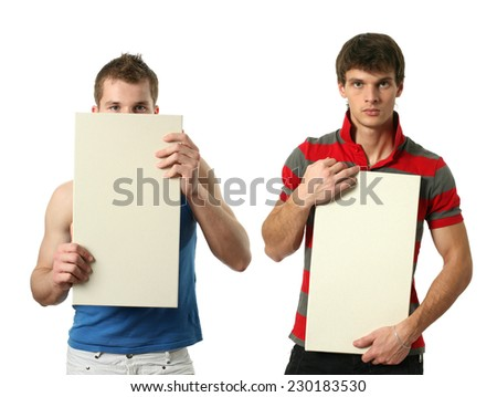 Two young sexy men with copy space blank signs isolated on white - stock photo