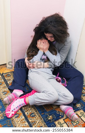 Two Young Sisters Crying. Concept: Domestic and Family Violence. Abuse Child. - stock photo