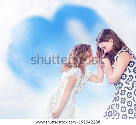 Two young sisters making funny faces, posing over sky background.