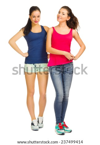 Two young smiling sporty girls isolated - stock photo