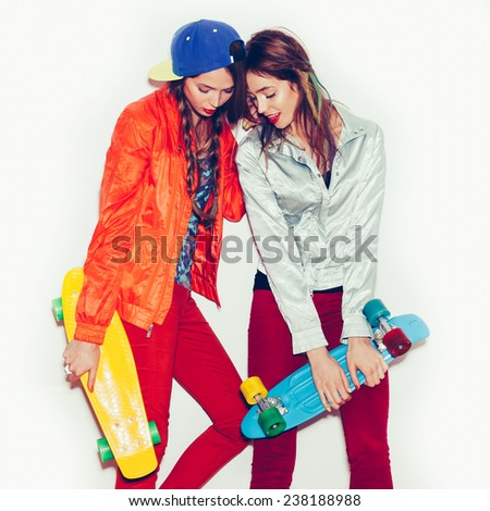 Two young sporty girl friends standing  together.  Emotion.  Hairstyle. Makeup.  White background, not isolated - stock photo