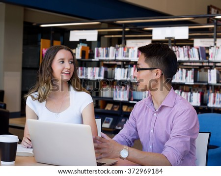 Two young students at the library