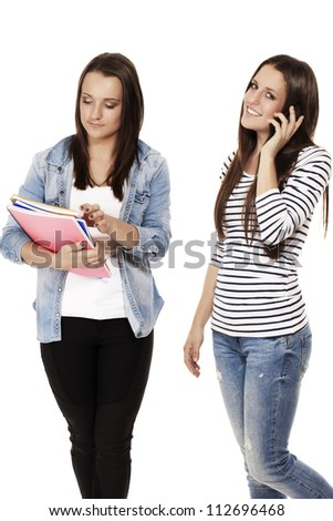 two young students one hanging on the phone on white background - stock photo
