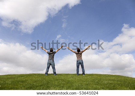 two young teenager enjoying the fresh air in the park - stock photo