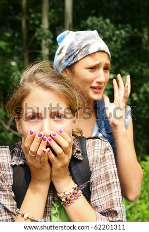 Two young teenagers looking scary in a forest