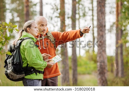 two young tourist determine the route map - stock photo