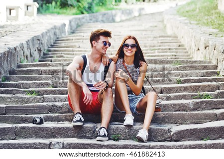 Two young tourists taking a break on old stairway