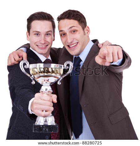 two young winning business men pointing to you, over white background