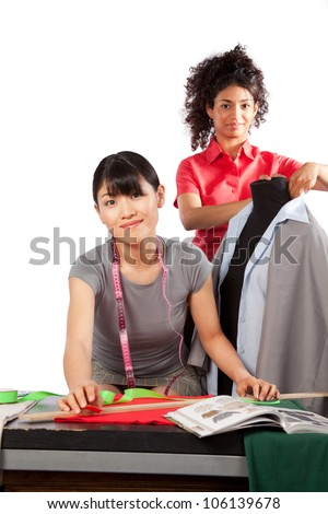 Two young woman dressmaker at work.