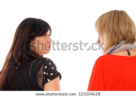 Two young woman look at each other / two woman - stock photo