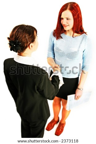 two young woman shake hands in work environment-isolated on white