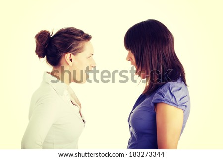 Two young womans arguing - stock photo