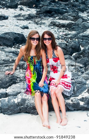 Two young women at the beach - stock photo