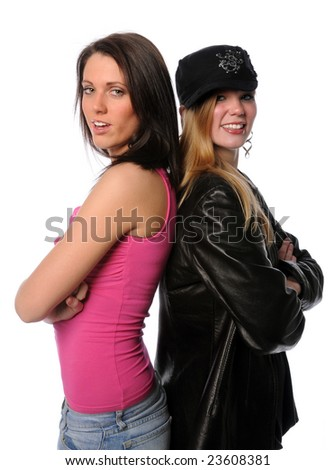Two young women back to back smiling isolated over a white background - stock photo
