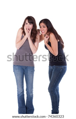 Two young women, casually dressed, looking terrified.