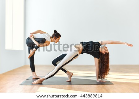 Two young women dancing in gym - stock photo