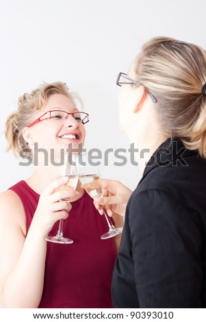 Two young women enjoying business party. - stock photo