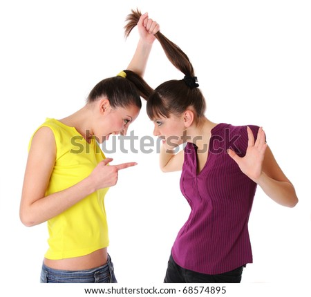 Two young women fighting. Isolated at white background