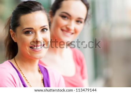 two young women friends closeup portrait - stock photo