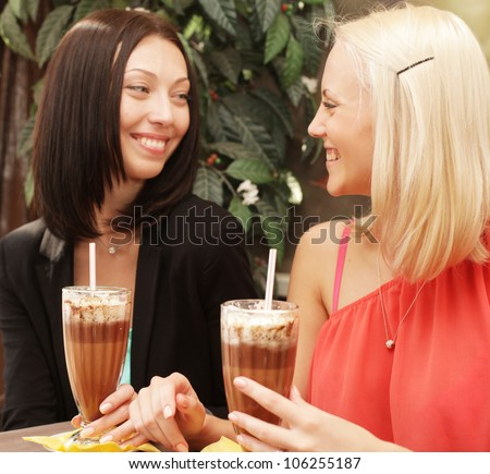 Two young women having coffee break together