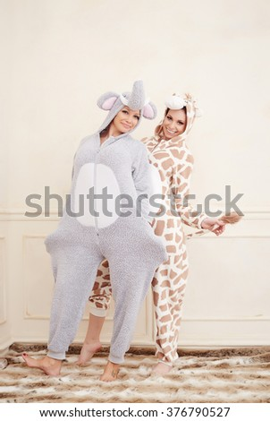 Two young women in a pajamas having fun.