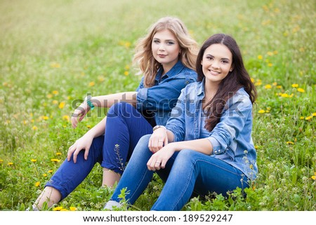 two young women in park having good time