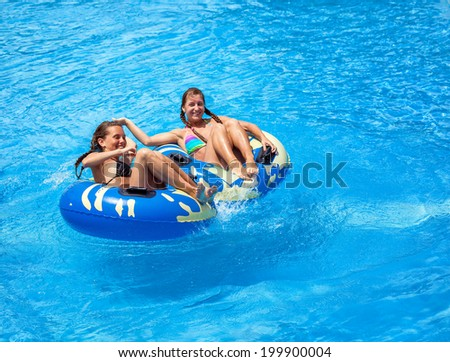 Two young women in the swimming pool