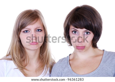 two young women making a face