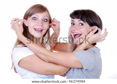 two young women making funny faces - stock photo