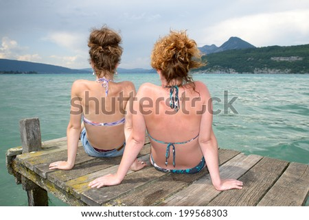 two young women natural tan at the waterfront