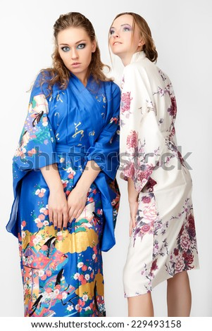 Two young women`s in Japanese kimono isolated on white background - stock photo