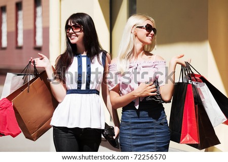 Two young women shopping - stock photo