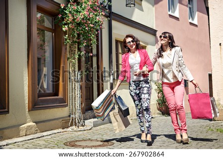 two young women shopping in the city - stock photo