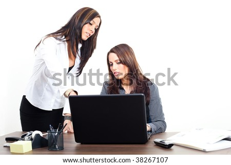 Two young women with a notebook