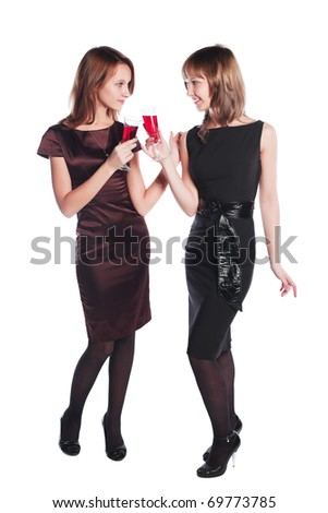 Two young women with a red wine - stock photo