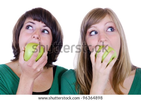 two young women with apples